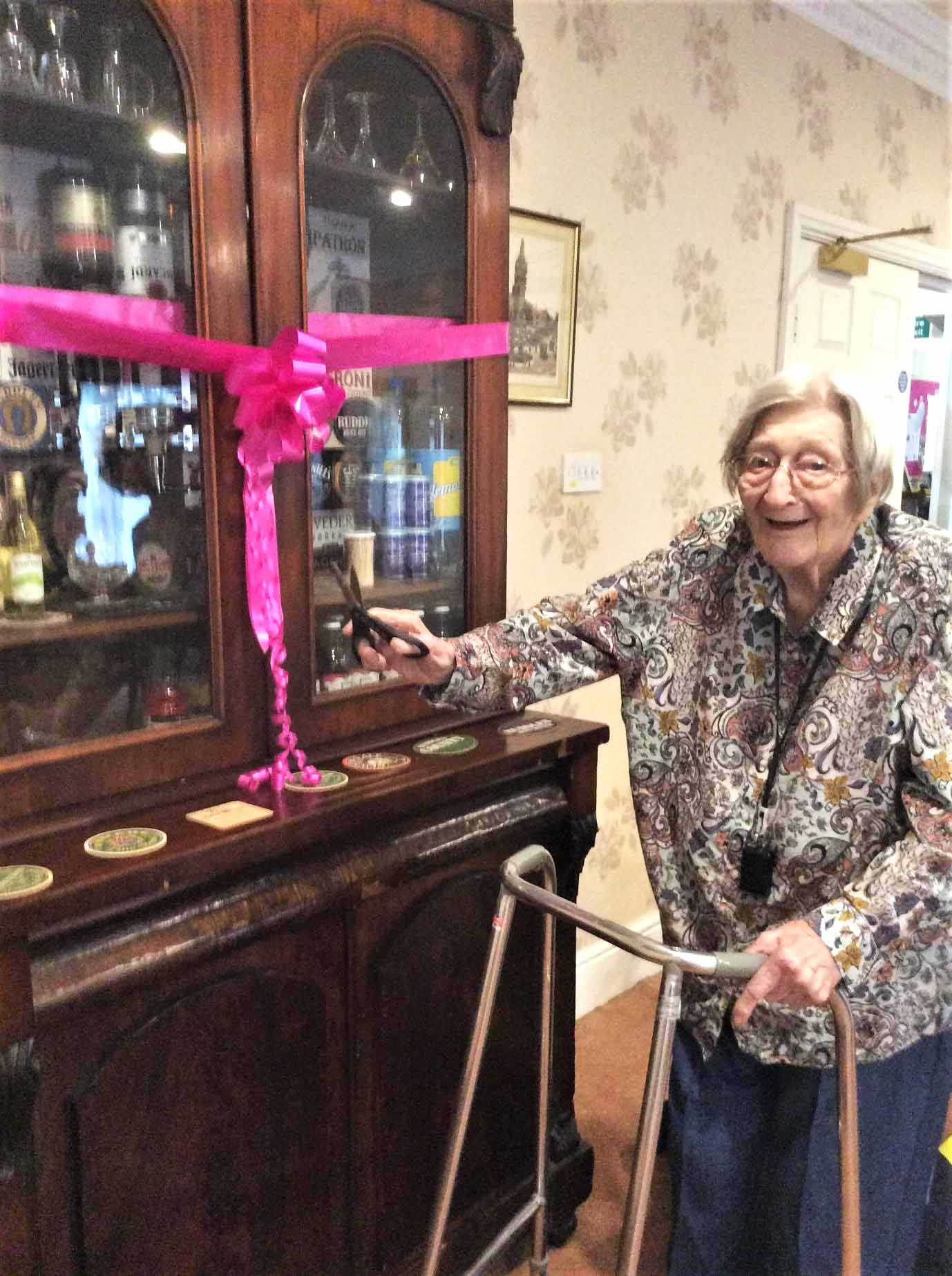 """Cheers"" to resident Joyce's new bar at The Lawns Care Home in Oadby"