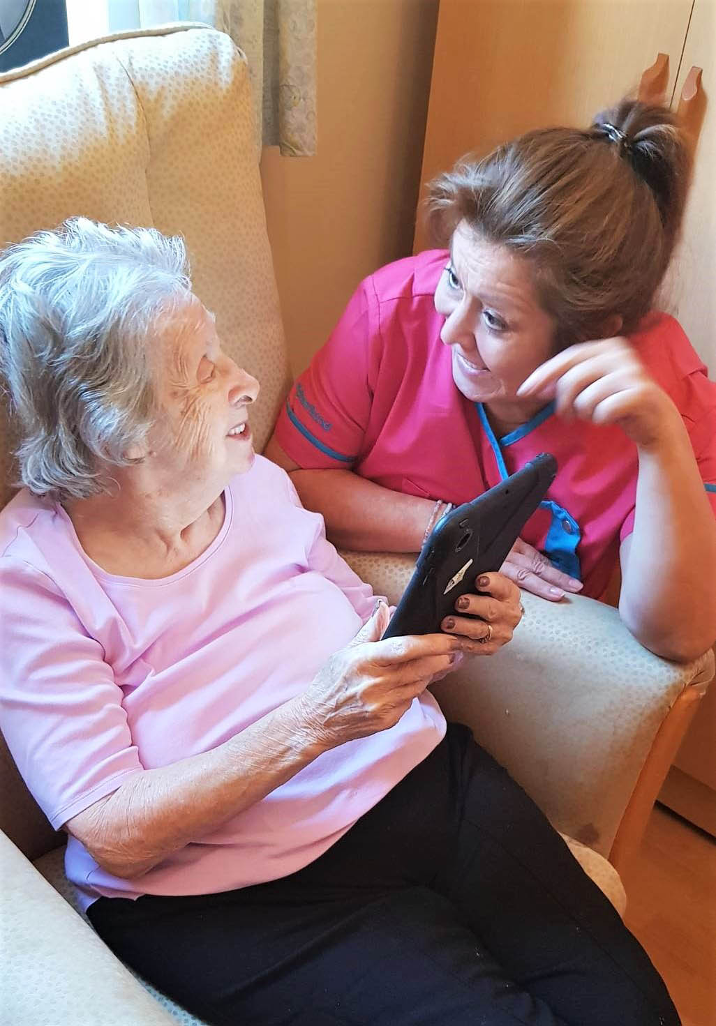 Residents at Henleigh Hall Care Home enjoy reminiscing with our new Magic Moments Club App