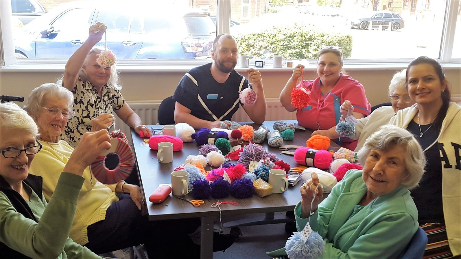 Residents at Broadway Halls Care Home in Dudley making pom poms to tackle loneliness