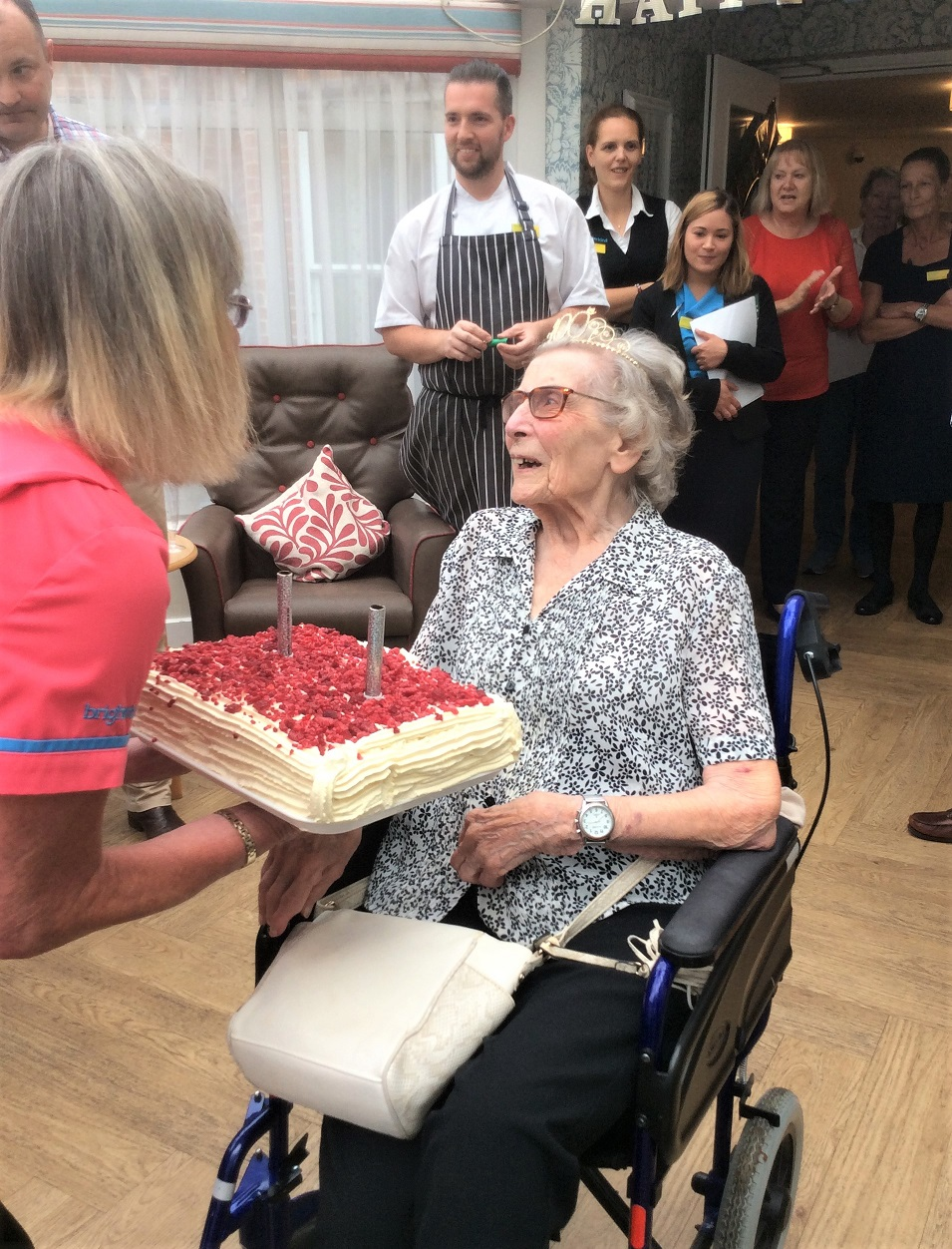 Albany Care Home, Oxfordshire-Resident Iris is presented with her birthday cake, made specially by our Chef Marek