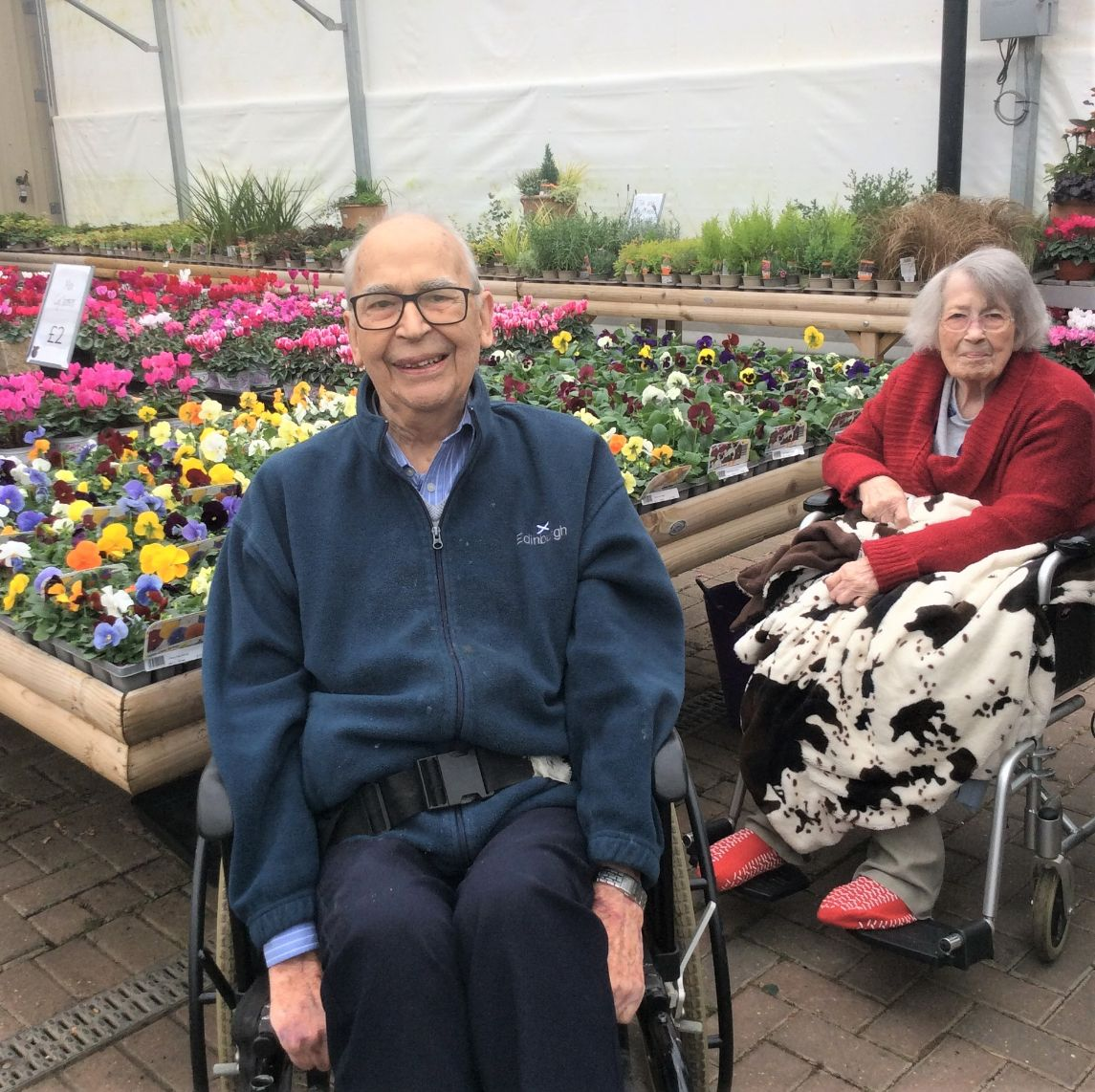 Albany Care Home, Oxfordshire-Residents Father Peter and Mrs Doyle enjoying the flowers at the garden centre