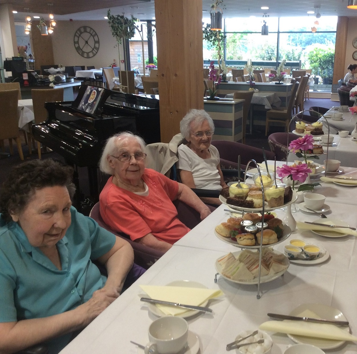 Residents Julie Lee, Florrie Lockett and Trudy Charnock enjoying their afternoon tea