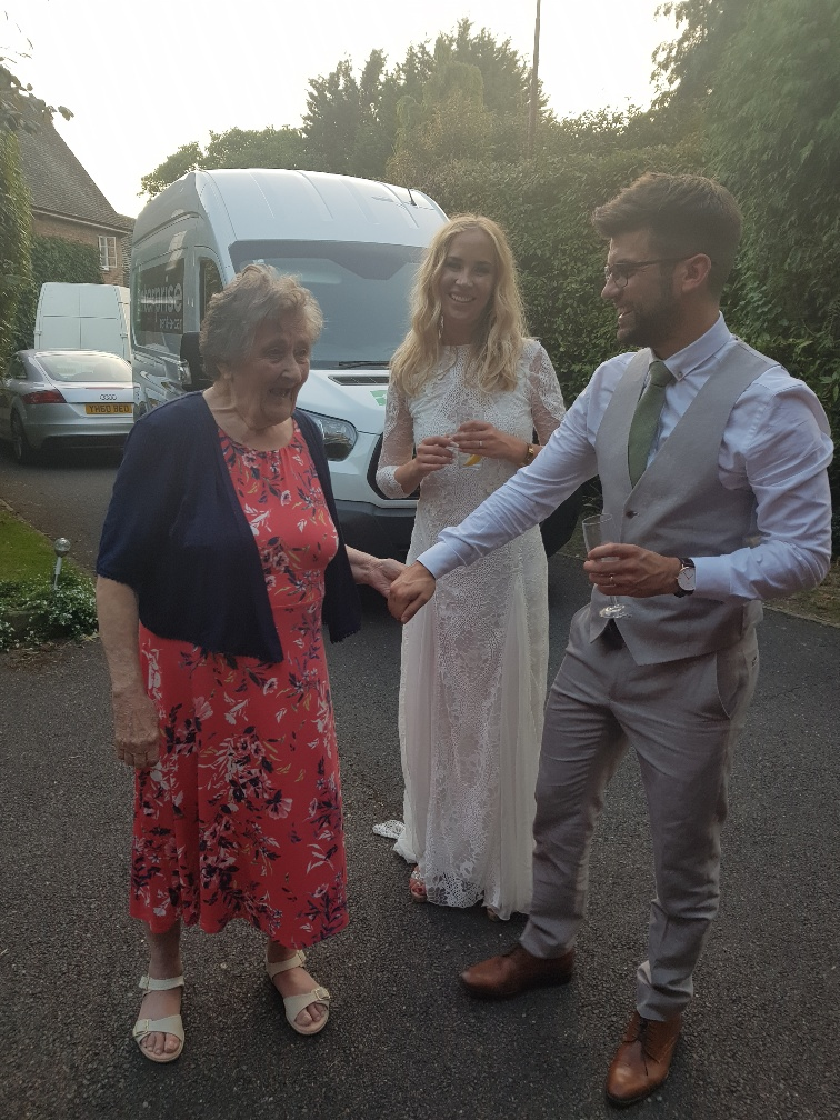 Val takes Tom's hand whilst her granddaughter Laura looks on