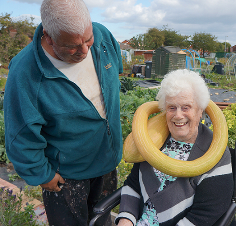 Allotment Chairman Eric with resident Flo modelling a squash necklace!
