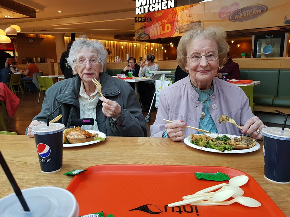 Residents Iris and Ruth tucking into their meals after the film
