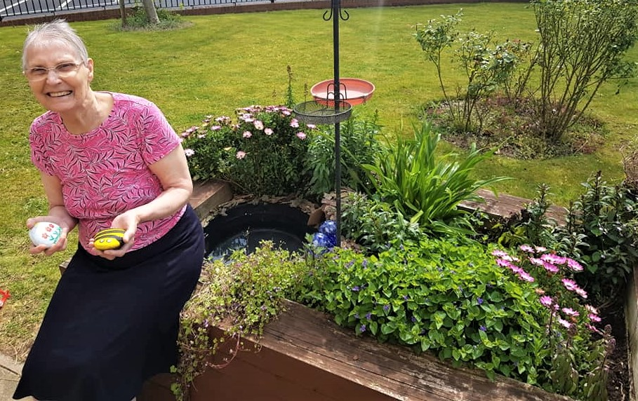 Broadway Halls Care Home, Dudley-Resident Eve with hand-painted pebbles for our secret garden