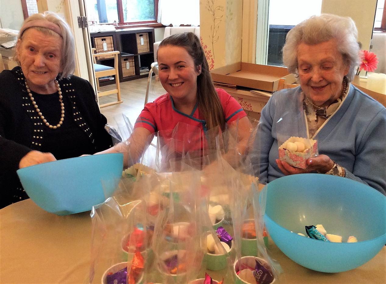 Resident Rita, Magic Moments Club Coordinator Holly and resident Betty having a 'sweet' time together!