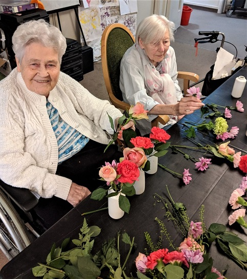 Charlotte House Care Home, The Wirral-June and Eileen enjoying our flower arranging activity