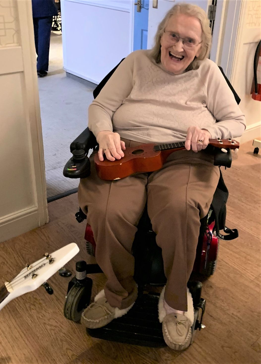 Charlotte House Care Home, The Wirral-Resident Myra had great fun trying out the ukulele