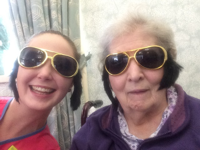Magic Moments Club Assistant Kim with resident Agnes rocking the Elvis look!