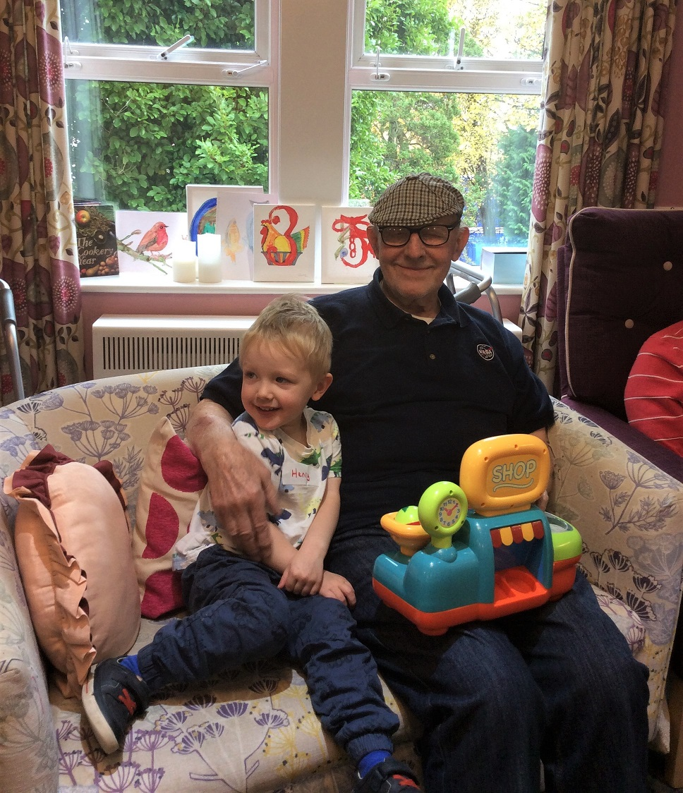 Cookridge Court Care Home-Henry and resident Cedric enjoying spending time together