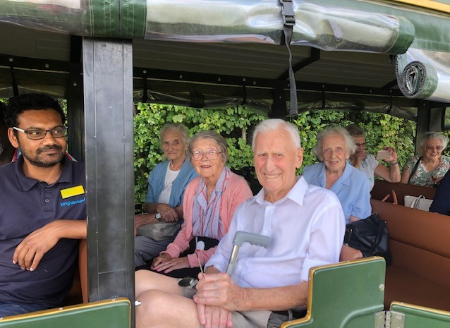 Cossins House Care Home, Surrey-Enjoying a tour of the Denbies vineyard on the estate's train