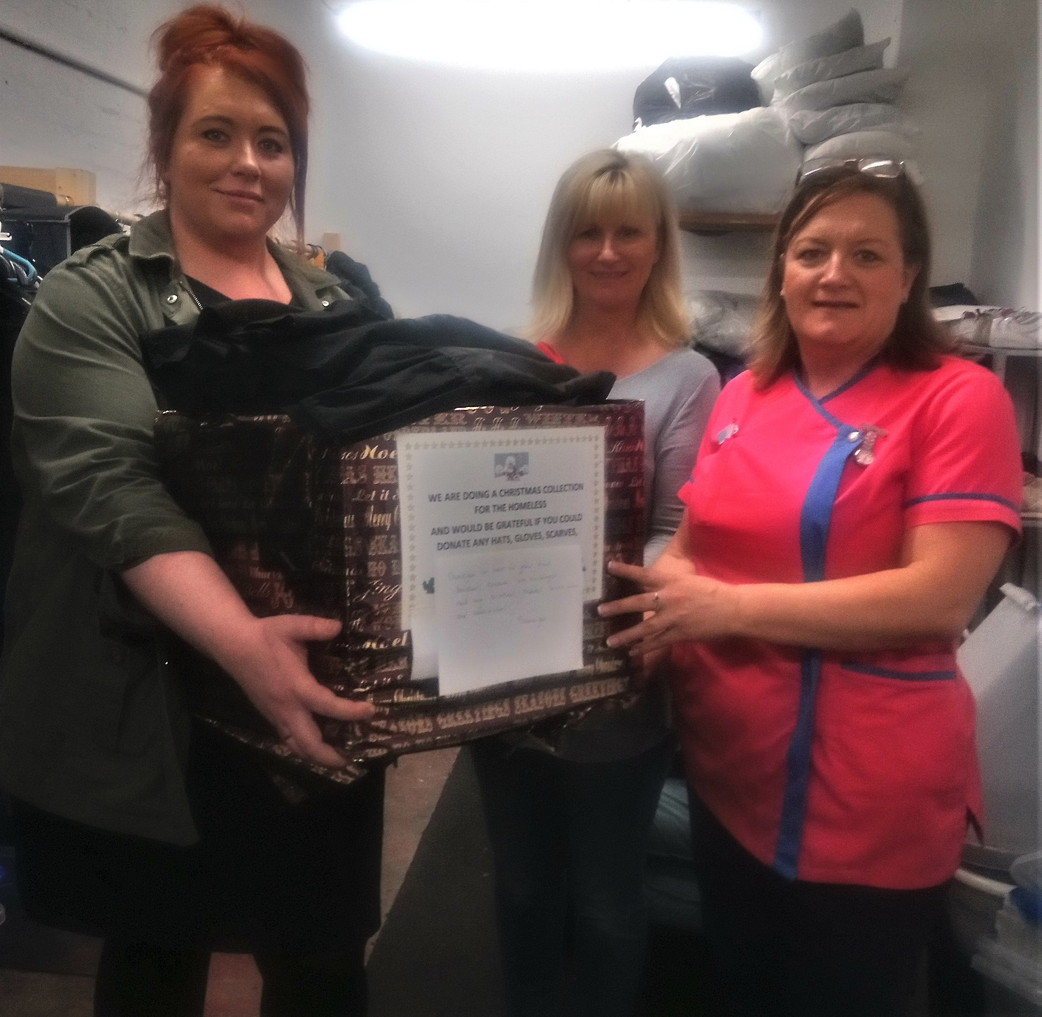 Crabwall Hall Care Home, Chester-Home Manager Kirsty and Magic Moments Club Coordinator Carolyn gives one of our parcels to the volunteer at Share Shop