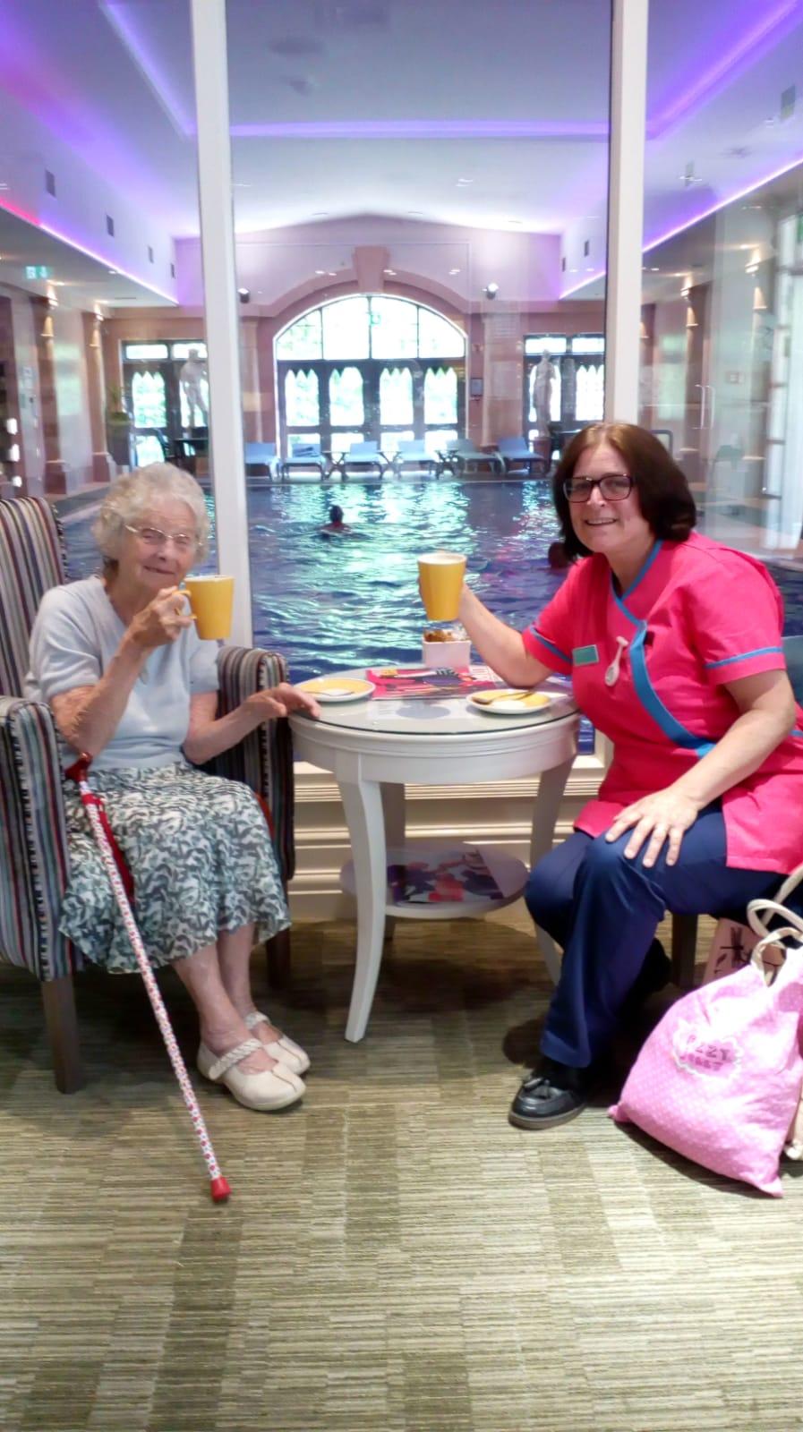 Resident Jean Dennett and Activities Coordinator Karen Robinson enjoy a cuppa together after their swim