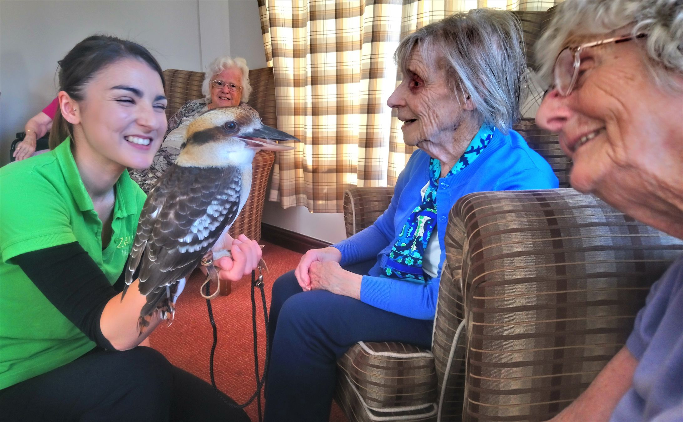 Crabwall Hall Care Home, Chester-Residents Audrey, Daphne and Jean meet the very noisy kookaburra