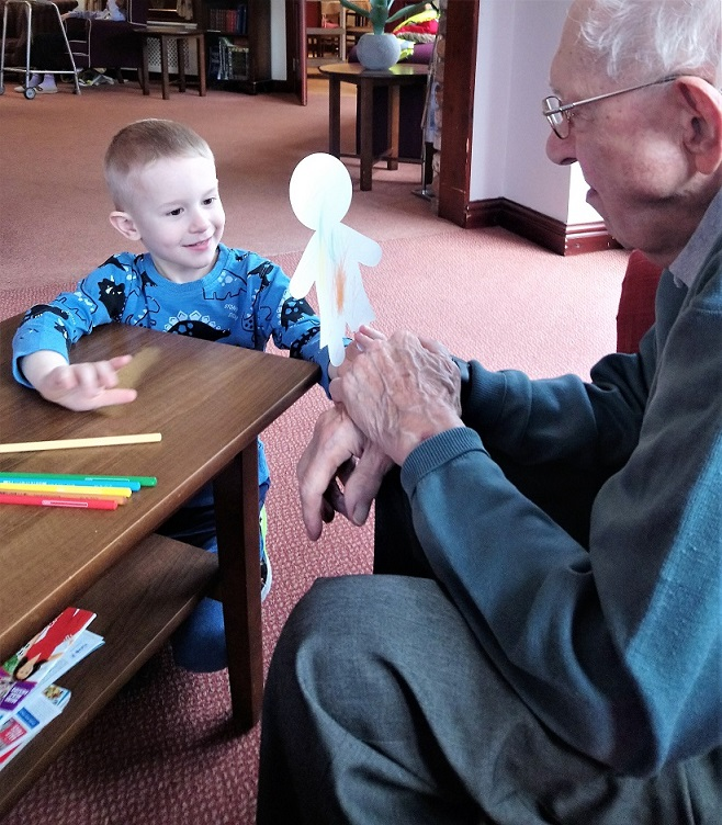 Our respite resident Trevor looking at the handy work of one little artist