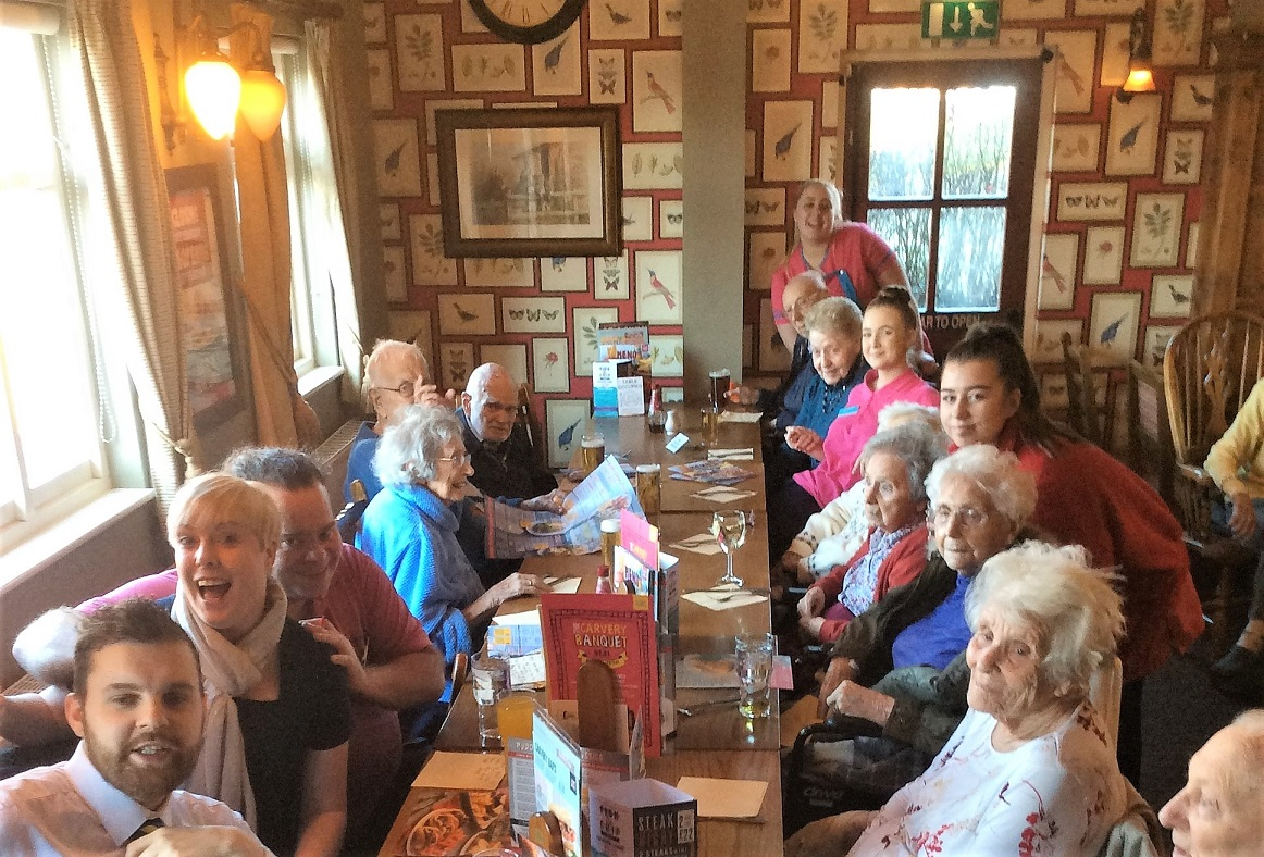 Residents and team members enjoying their lunch out together at The Trading Post
