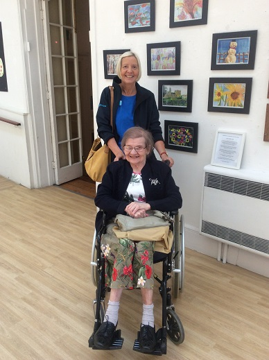 Residents attend a dementia art exhibition