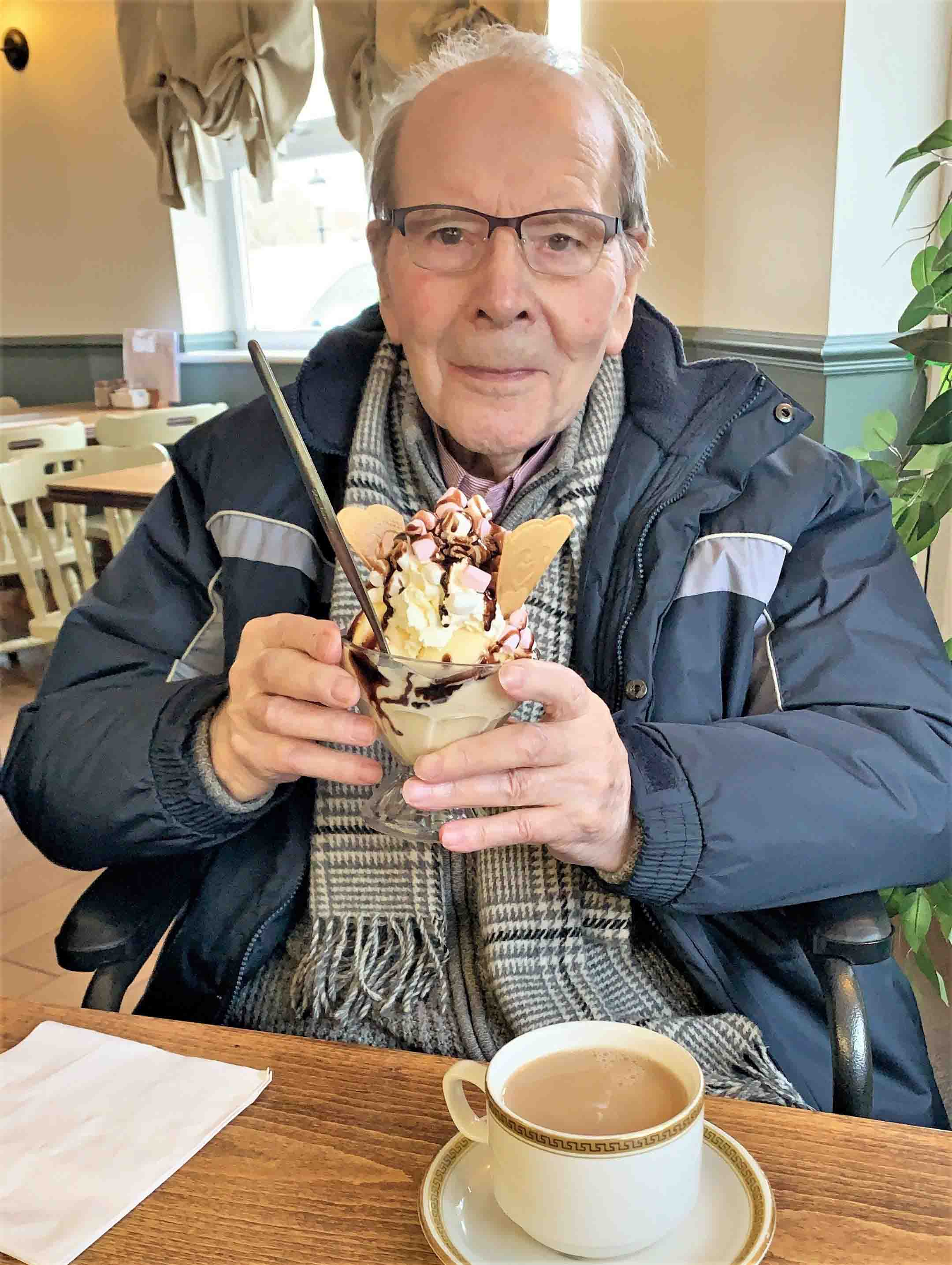 A resident at Flowerdown Care Home in Winchester treats his sweet tooth to an ice cream sundae