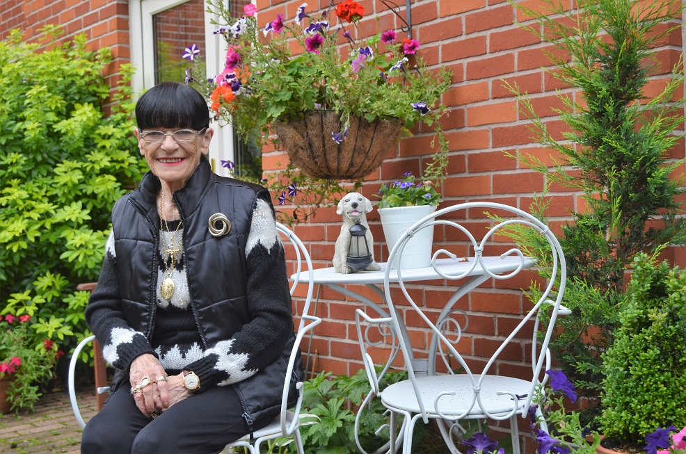 Resident Hazel pictured in the glorious garden she has helped to create
