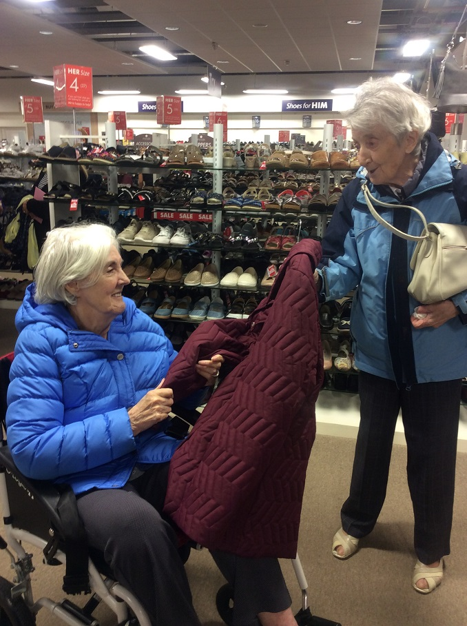 Residents May and Cathy checking the quality of the jackets