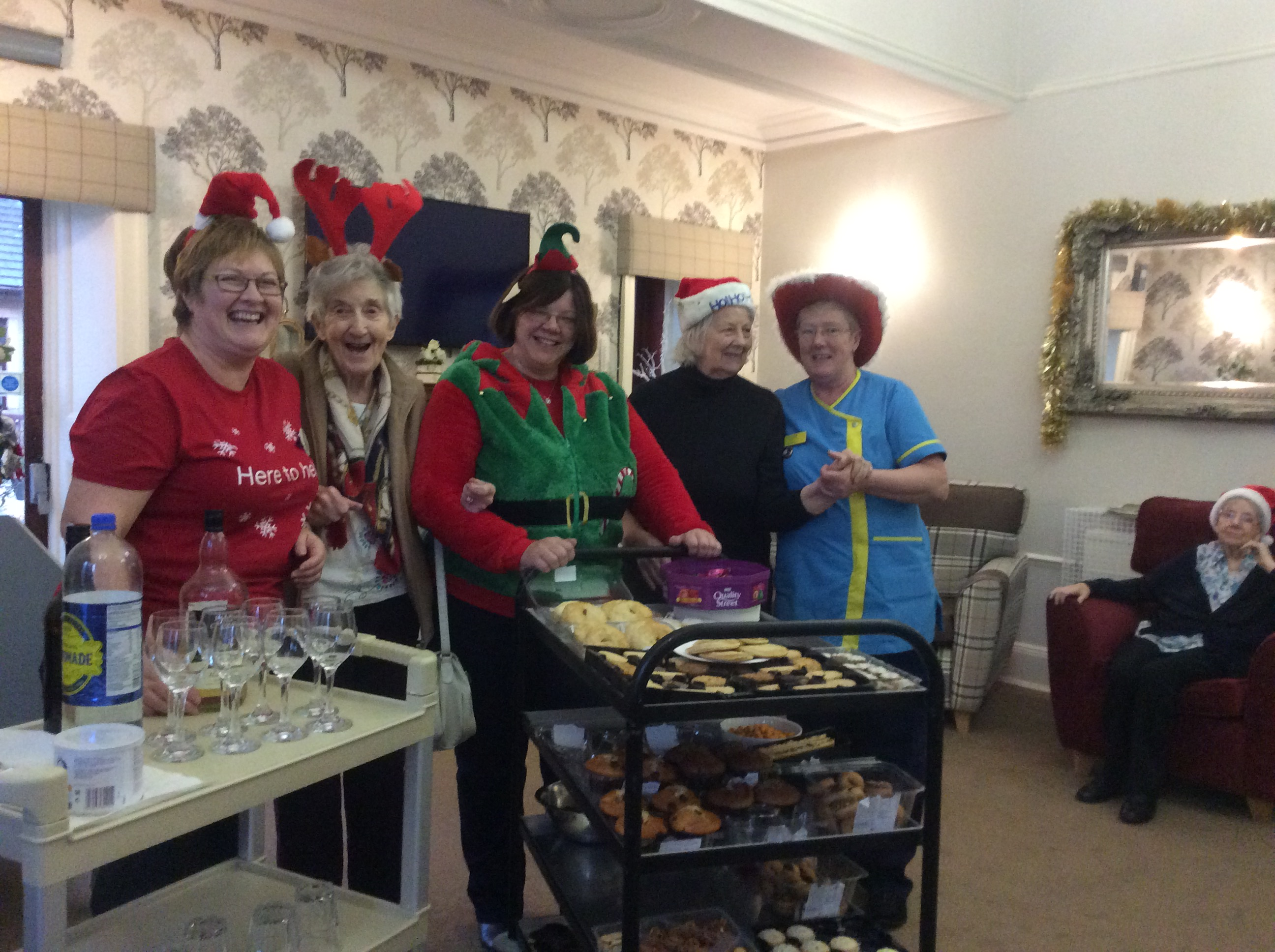 Tesco team members with residents and Carer Carol Currie with the Christmas goodies!