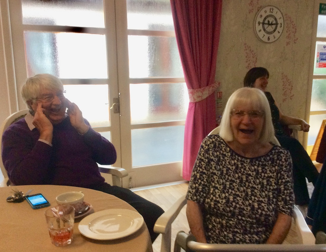 Resident Betty and her son enjoying some laughter yoga