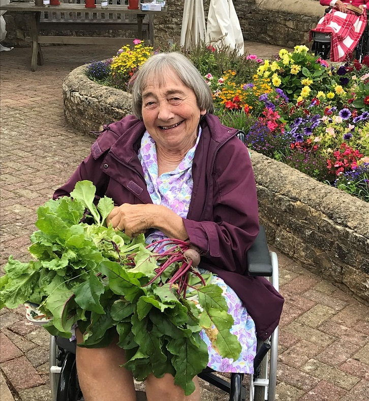 Resident Elizabeth Wilson with some of our homegrown produce