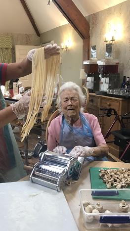 Resident Kay Hazlewood using the pasta machine like a true Italian chef!