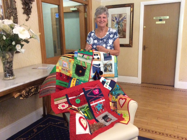 Jean Williams with some of the many sensory blankets she has created for our residents