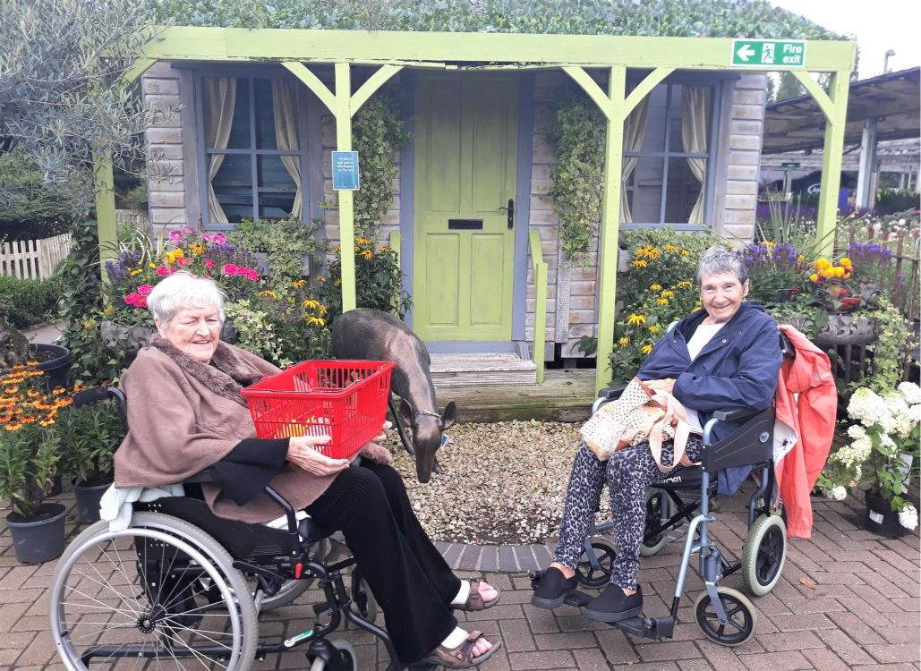 Highfield Care Home, Ware-Residents Violet and Margaret surrounded by beautiful blooms at the garden centre