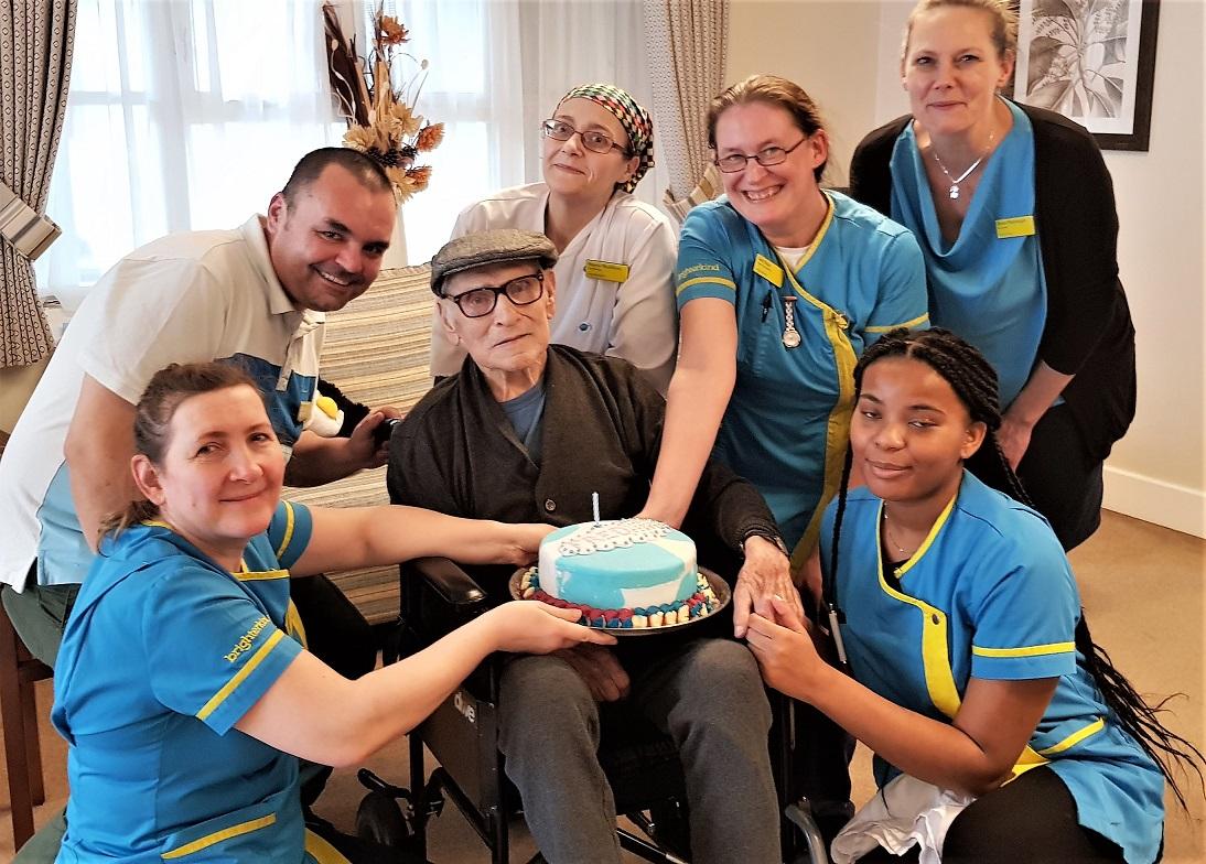 Resident Fredrick celebrating his birthday with team members Bozena, Ioan, Valarie, Lisa, Helen and Naketa