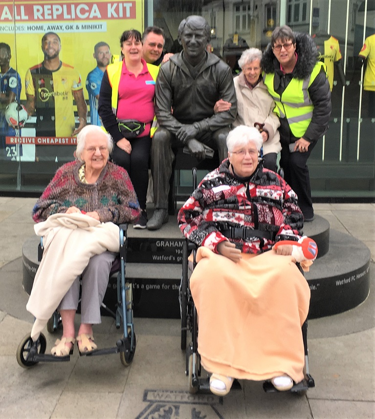 Houndswood House Care Home, Hertfordshire-Residents and team members with the statue of Graham Taylor outside Watford Football Club
