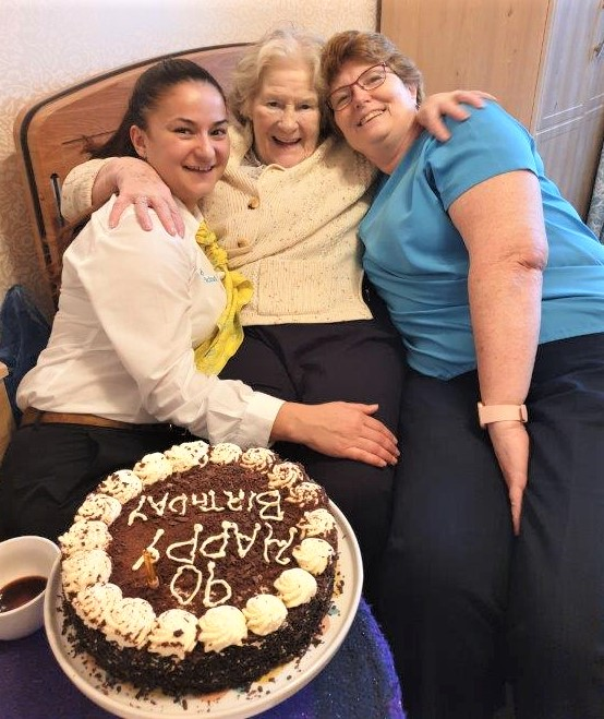 Hungerford Care Home, Berkshire-Deputy Manager Laura, resident Doris and Home Manager Ronnie with the birthday girl's favourite cake!