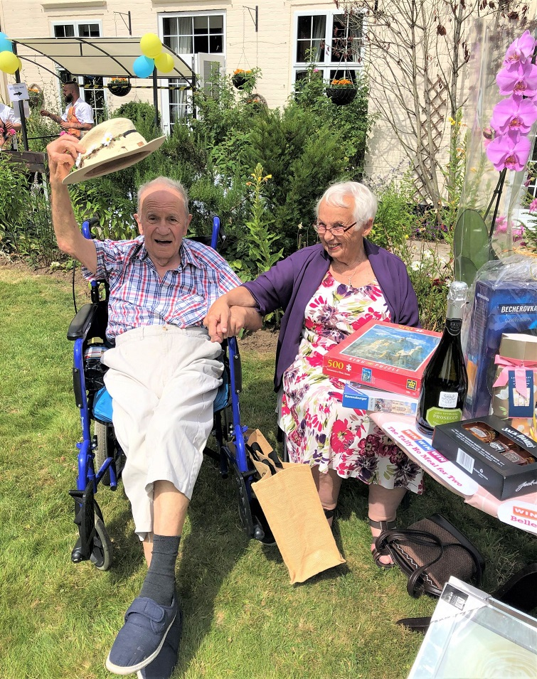 Hungerford Care Home, Berkshire-Hats off to summer. Resident Royston and Sylvia enjoying our festival