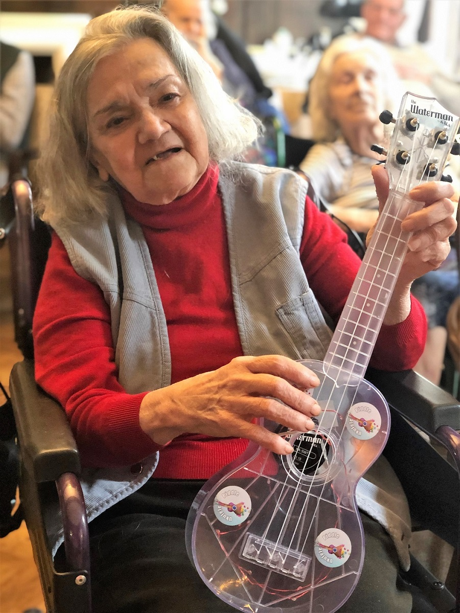 Hungerford Care Home, Berkshire-Resident Patricia has a go at playing the ukulele - she did a grand job!