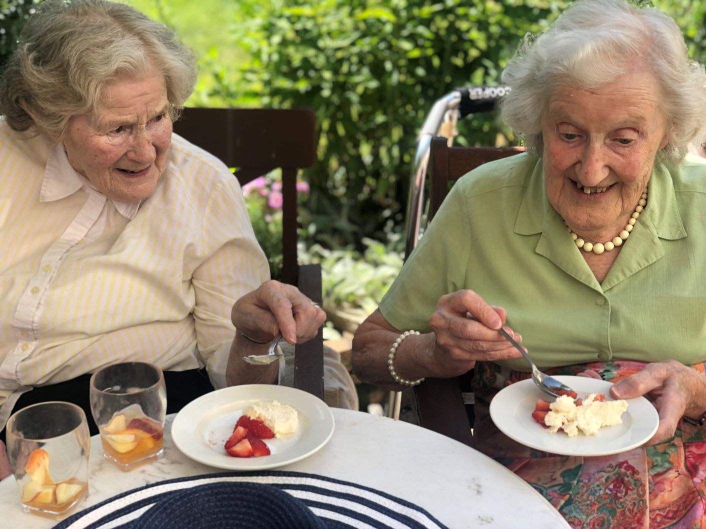 Hungerford Care Home, Berkshire-Residents Doris and Audrey enjoying their strawberries and cream