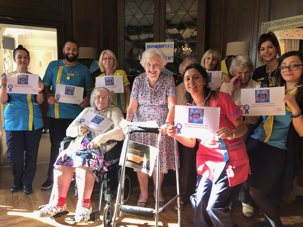 Residents and team members with their 'Wow Factor' achievement certificates