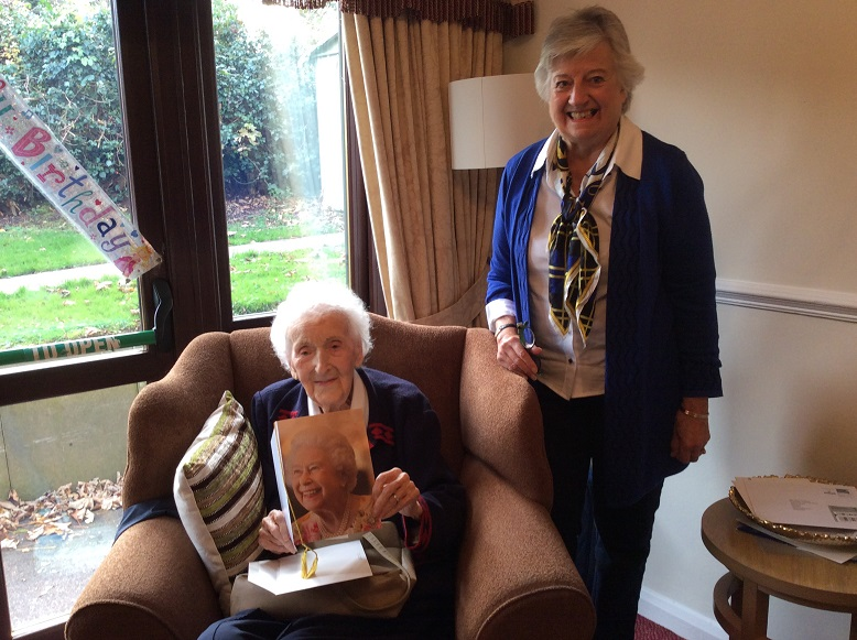 Mary and her niece, Julia reading her birthday card from the Queen.