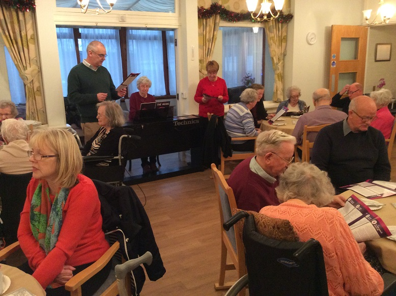 Residents and visitors singing along to the Christmas Carols