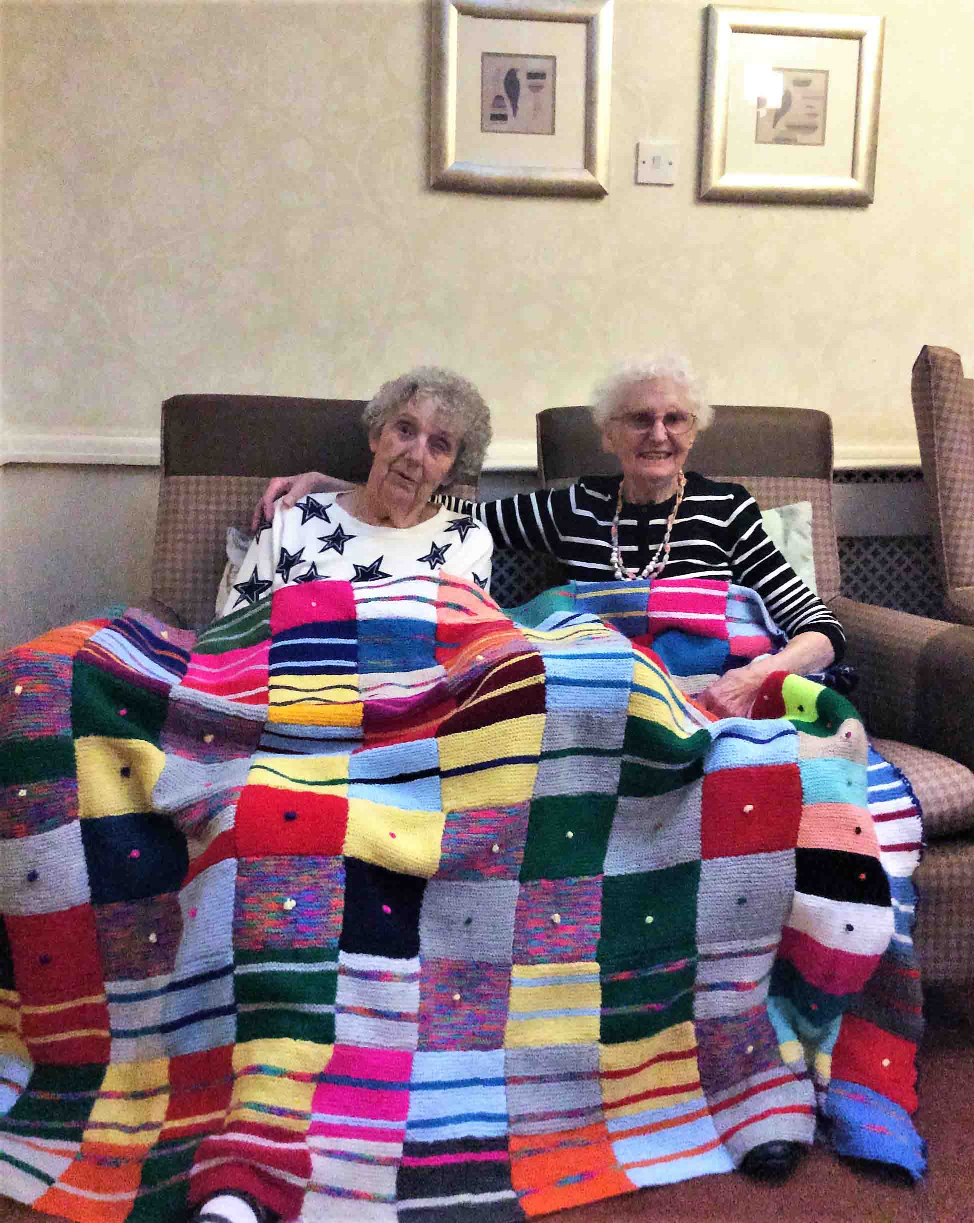 Residents at St. Oswalds House Care Home donate hand-knitted patchwork blanket to local homeless shelter