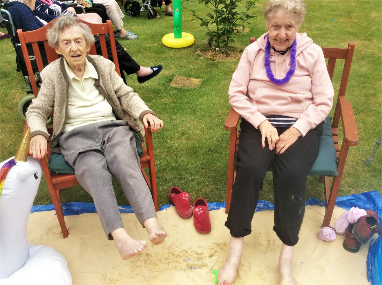 Residents at Elm Bank Care Home in Kettering enjoy a hawaiian-themed summer garden party