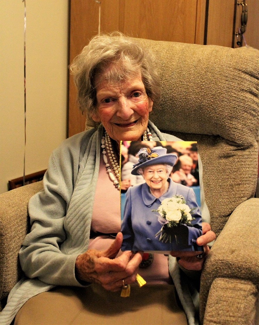 Ivybank House Care Home, Bath-Birthday girl Sybil with her card from HM The Queen