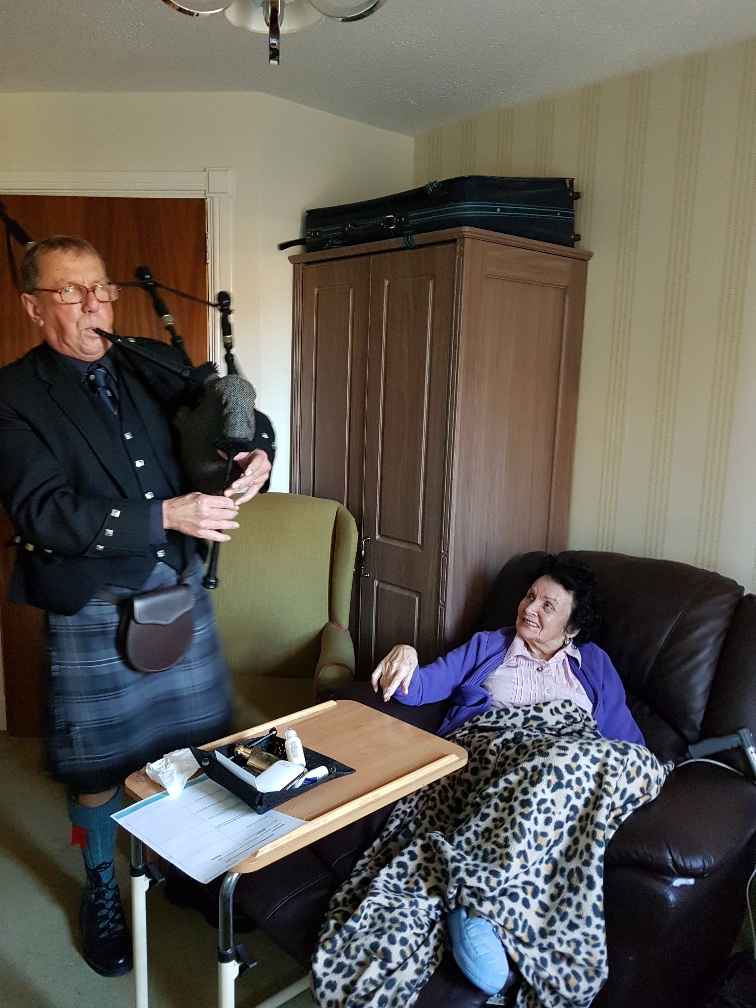 Joyce enjoying the bagpipe tunes