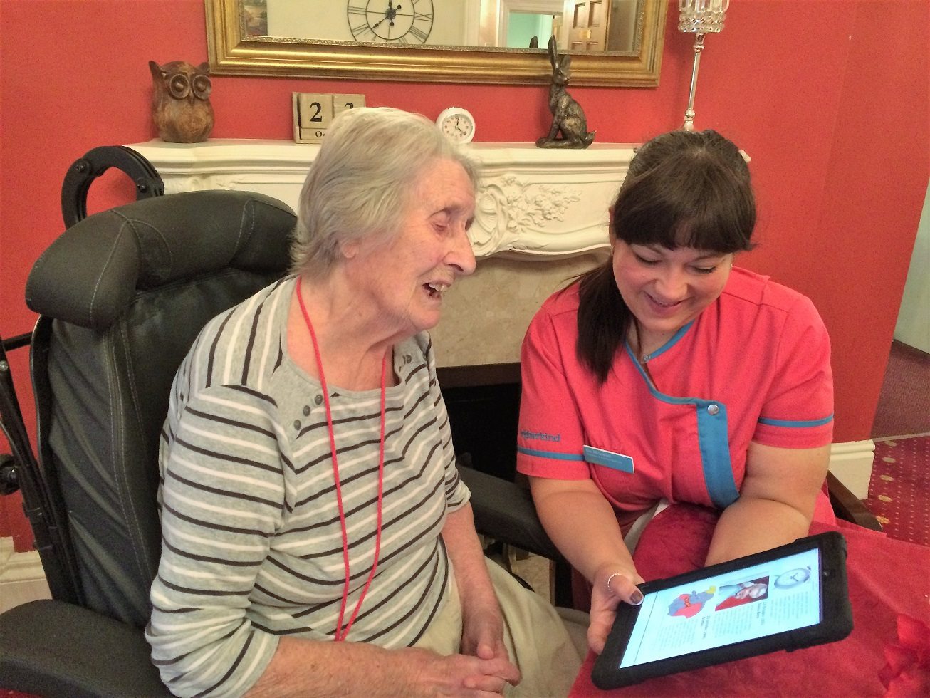 Resident Joan Key and Magic Moments Club Coordinator Liz Maxwell exploring our new App together