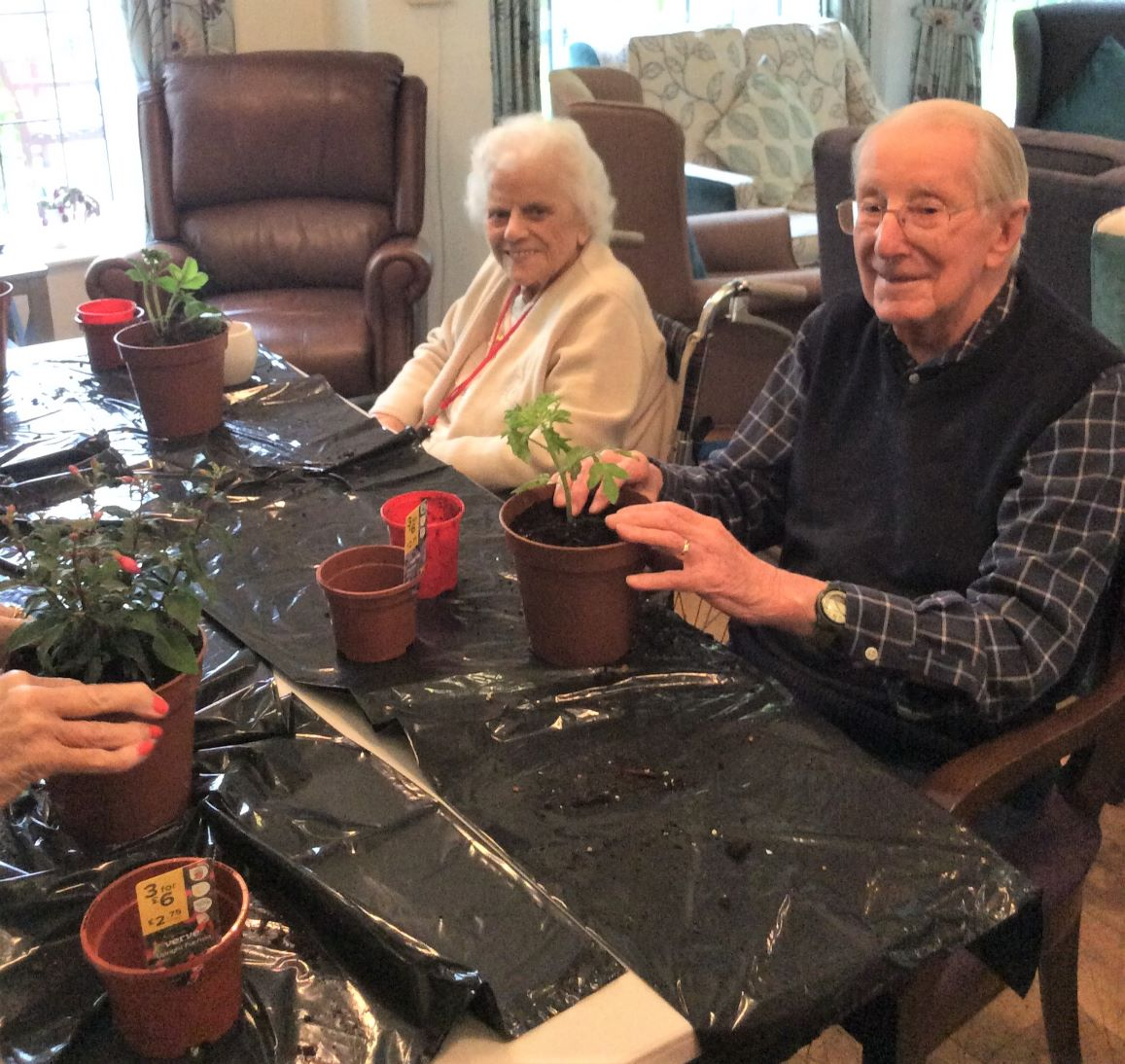 Lawton Manor Care Home, Staffordshire-Residents Brenda and Roy busy potting plants