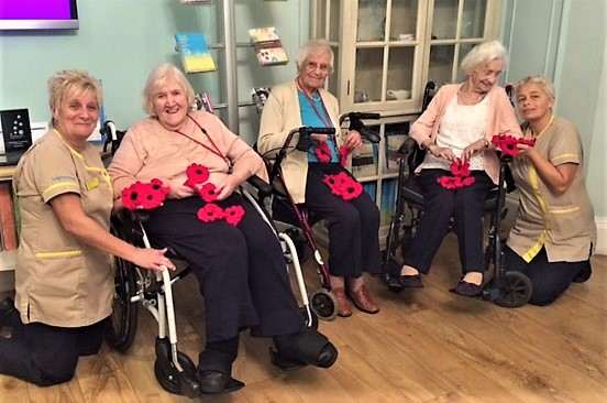 Our knitting club members with their wonderful poppies. Team member Yvonne Seldon, residents Bridgette Hargrove, Alice Baxter and Majorie Andrew, and Team member Diane Phillips
