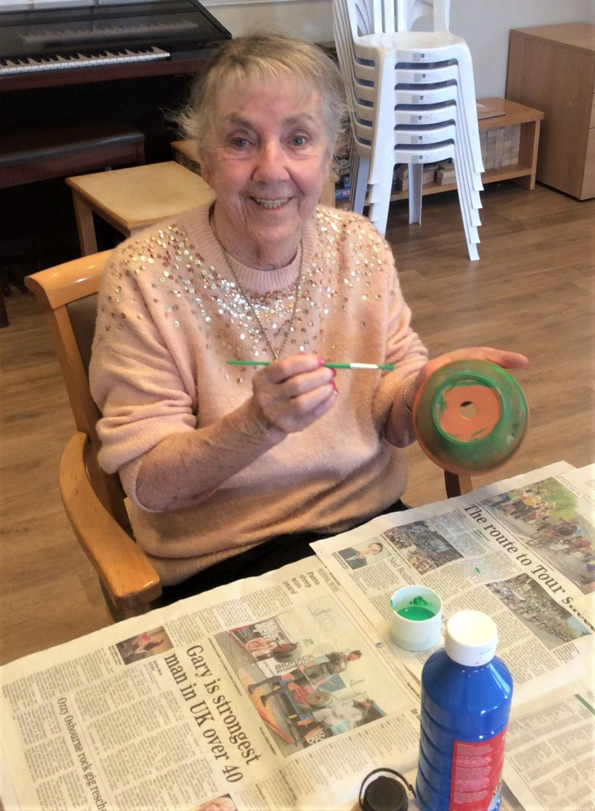 Leeming Bar Grange Care Home, North Yorkshire-Resident Mavis painting her personalised plant pot
