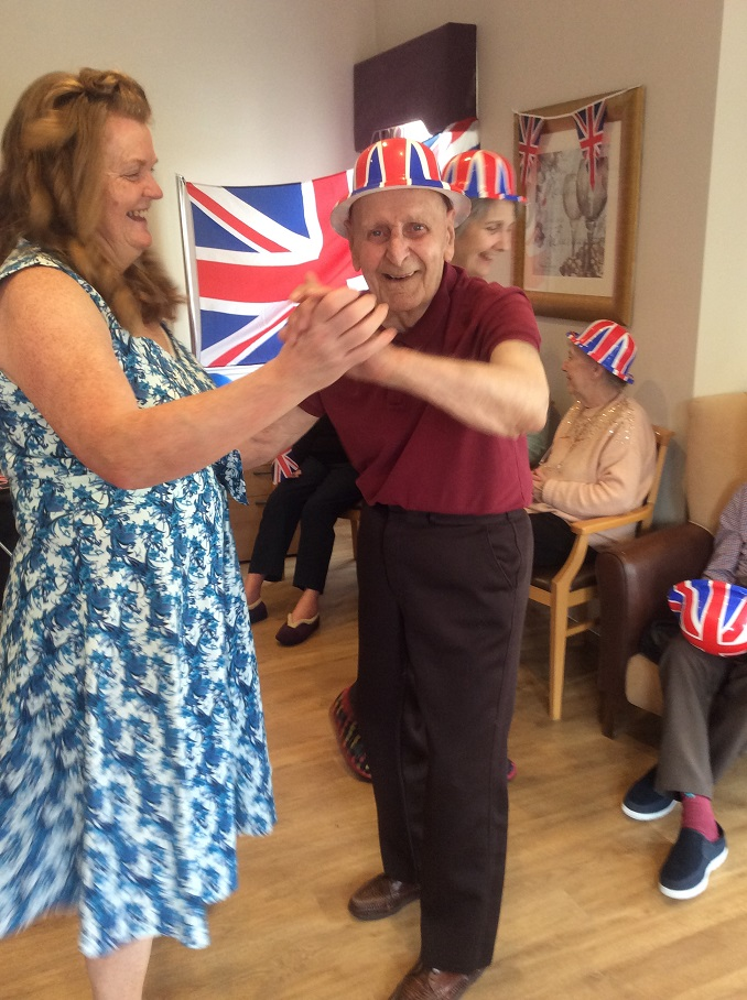 Leeming Bar Grange Care Home-Team member Tracey dancing with resident Jack