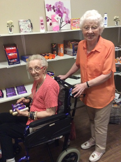 Sylvia and Margaret stocking up on essential supplies... Chocolate!